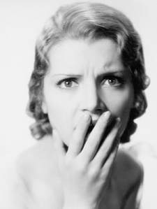 vintage-woman-black-and-white-hand-over-mouth-shock-surprise